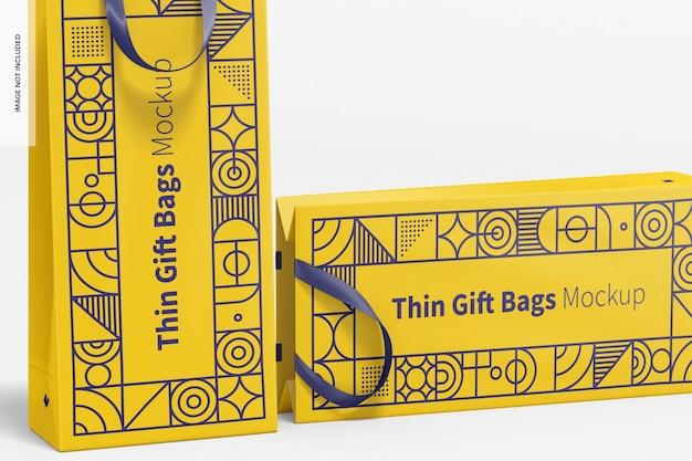 Sacs-cadeaux minces avec maquette de poignée en ruban, gros plan