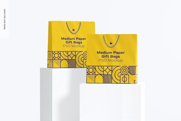 Sacs-cadeaux en papier moyens avec maquette de jeu de poignée en corde