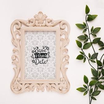Sauvez le cadre baroque de maquette de date avec des feuilles