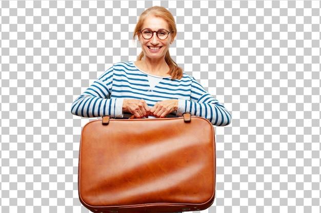 Senior belle femme avec un bagage en cuir