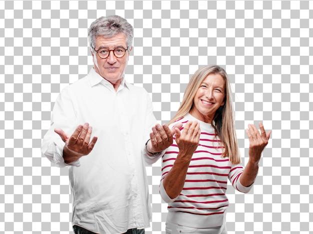 Senior mari et femme souriants avec un regard fier, satisfait et heureux