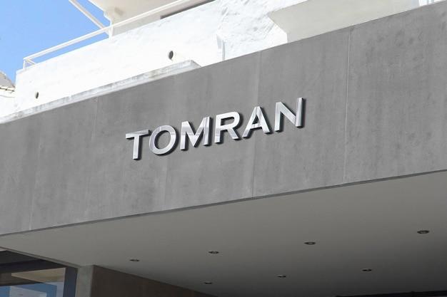 Signe de façade gris maquette logo chrome 3d