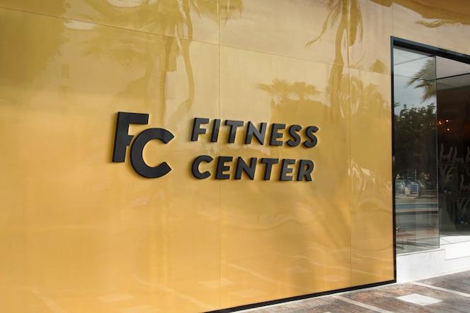 Signe de façade jaune moderne de maquette de logo