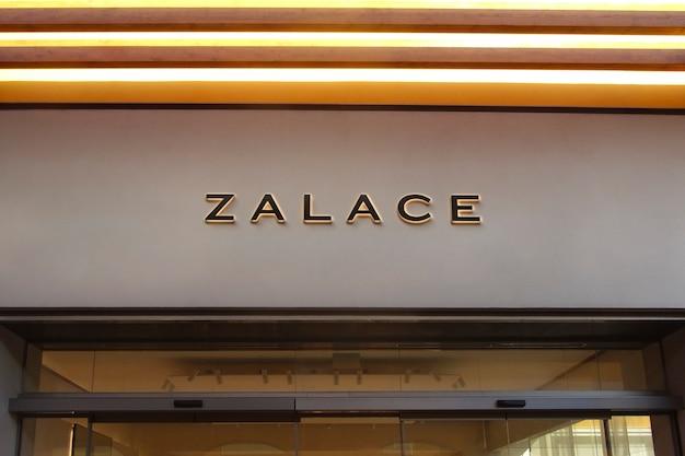 Signe de façade moderne de maquette de logo