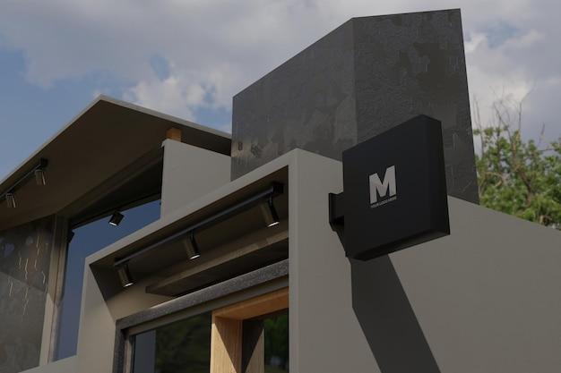 Signe de logo boîte de signalisation rectangle maquette sur la façade de l'immeuble de magasin de bureau