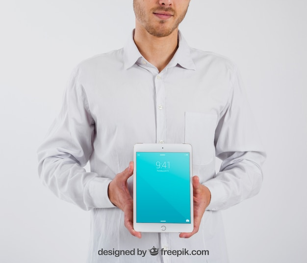 Smart businessman holding tablette