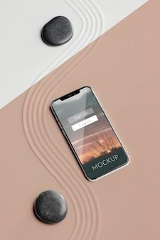 Smartphone maquette en arrangement de sable
