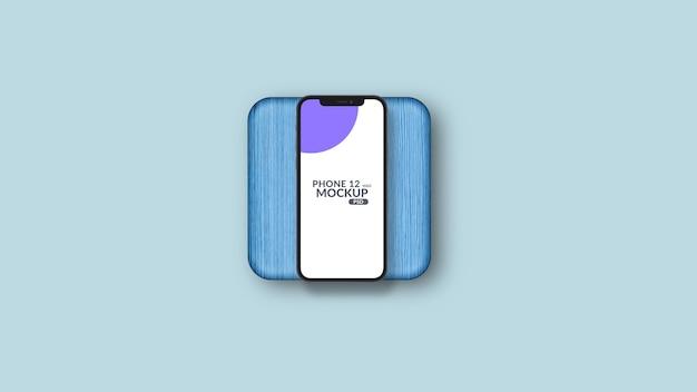 Smartphone sur maquette de morceau de bois bleu isolé