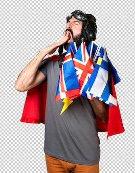Super-héros avec beaucoup de drapeaux bâillant
