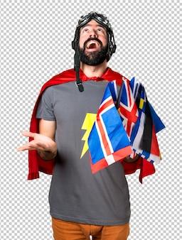 Super-héros avec beaucoup de drapeaux plaidant