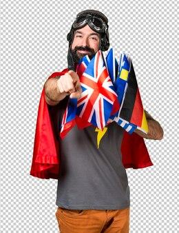 Super-héros avec beaucoup de drapeaux pointant vers l'avant