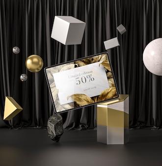 Tablette numérique avec concept abstrait de feuilles d'or