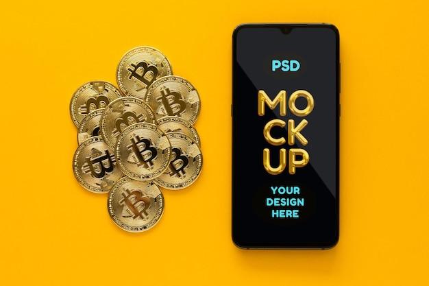 Tas de bitcoins et maquette de téléphone portable