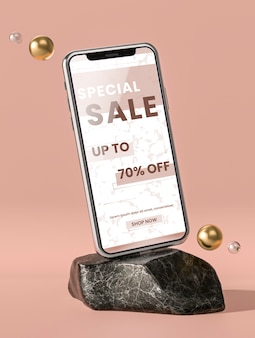 Téléphone mobile maquette 3d sur pierre de marbre