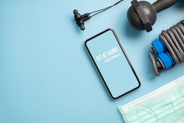 Téléphone mobile maquette pour healthy at home, soyez actif pendant la pandémie de virus. fight covid-19