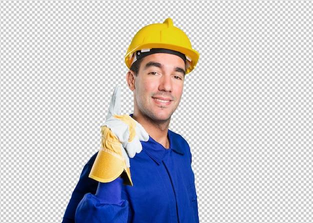 Travailleur confiant pointant sur fond blanc