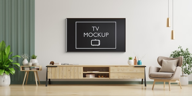 Tv sur le mur blanc dans le salon avec fauteuil, design minimaliste, rendu 3d