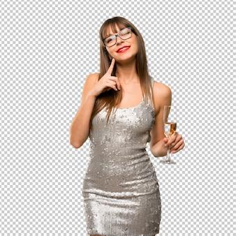 Vacances de noël. femme vêtue d'une robe à paillettes et champagne célébrant le nouvel an 20