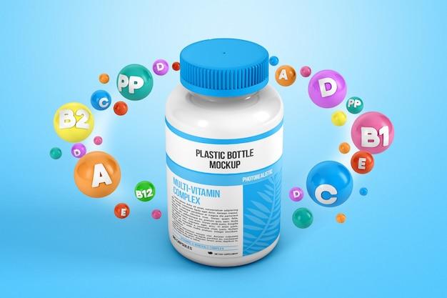 Vitamines autour d'une maquette de bouteille en plastique