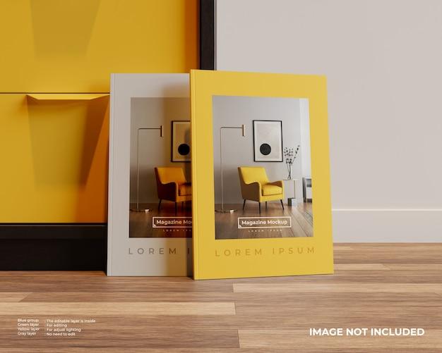 Vue avant de la maquette de deux magazines sur plancher de bois avec placard