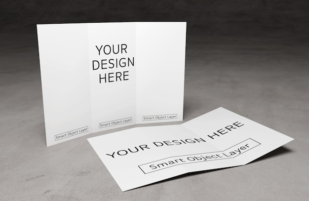 Vue d'une brochure à trois volets sur la maquette d'une table en ciment