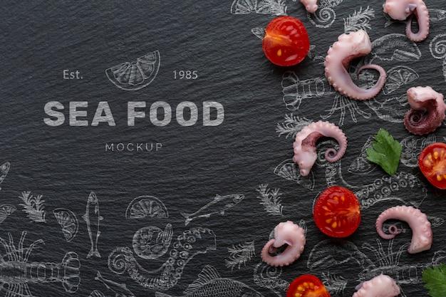 Vue de dessus arrangement de fruits de mer avec maquette