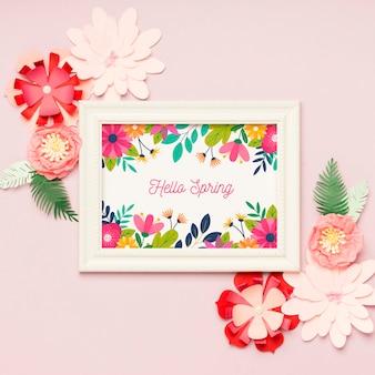 Vue de dessus bonjour concept de cadre de printemps avec des fleurs