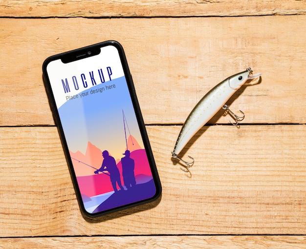 Vue de dessus du smartphone avec appât de poisson