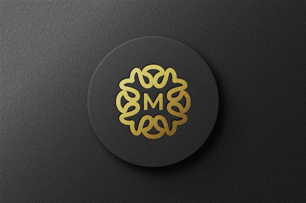 Vue de dessus de la maquette de logo doré en relief de luxe