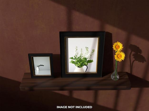 Vue de dessus maquette réaliste deux cadre photo avec fleur