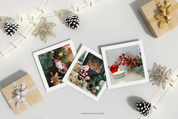 Vue de dessus des papiers de noël avec pin de noix et maquette de boîte de cadeaux