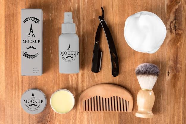 Vue de dessus des produits de salon de coiffure avec rasoir