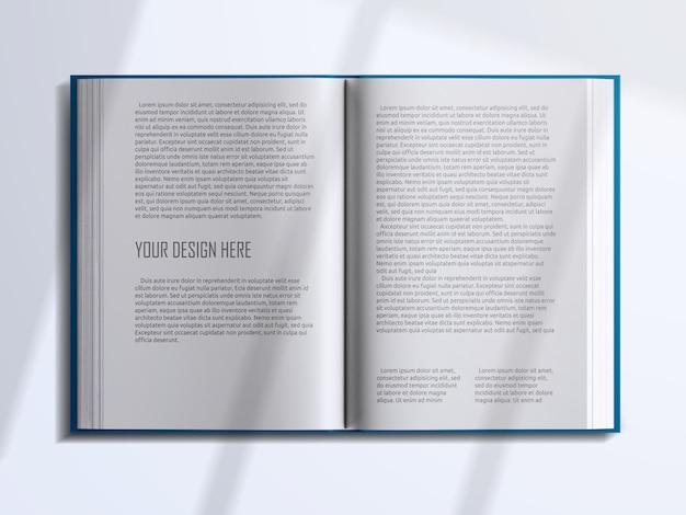 Vue de dessus réaliste pages de livre ouvertes avec maquette de superposition d'ombre