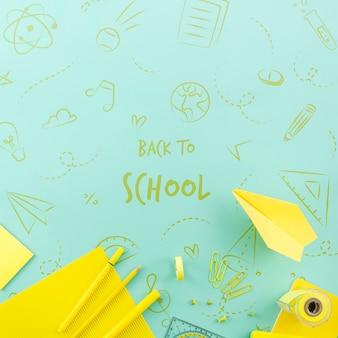 Vue de dessus retour à l'école avec des fournitures jaunes