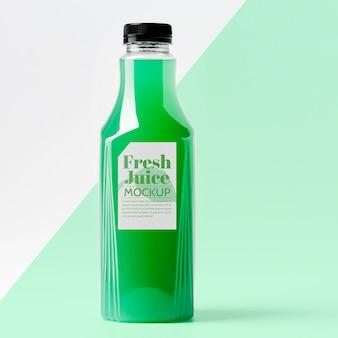 Vue de face de la bouteille de jus en verre avec bouchon