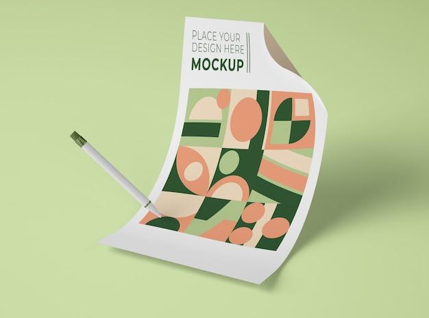 Vue de face du papier maquette avec des formes géométriques et un stylo