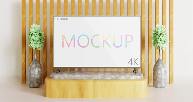 Vue de face de la maquette de télévision en couleur sur la table en pierre minimaliste