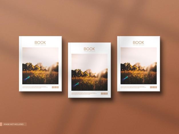 Vue de face trois maquette de couverture de livre dur