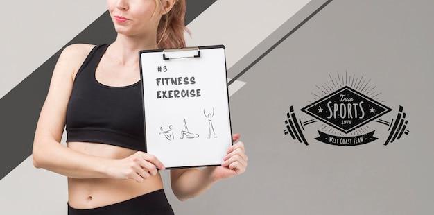 Vue frontale, de, athlétique, femme, tenue, bloc-notes