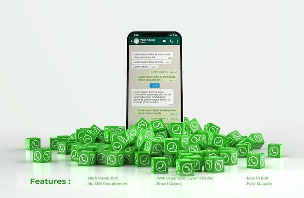 Whatsapp sur une maquette de téléphone portable avec une pile éparpillée d'icône de cubes whatsapp