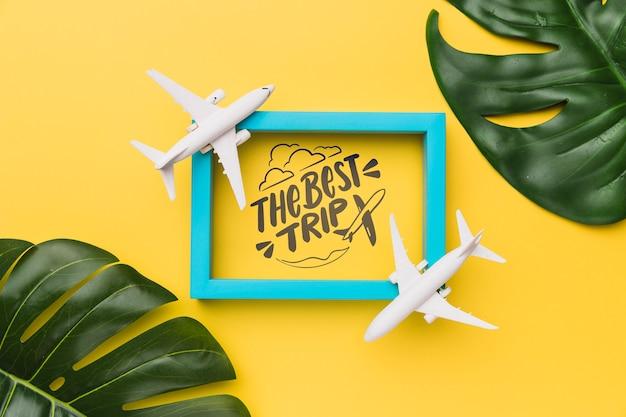A melhor viagem, letras com moldura, aviões e folhas de palmeira