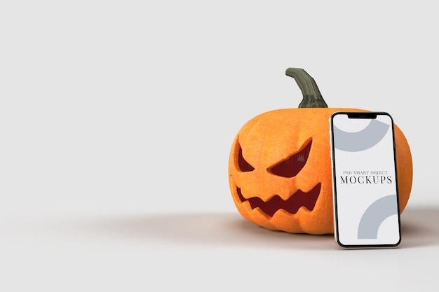 Abóboras de mock-up de halloween com smartphone. maquete do conceito de halloween
