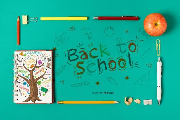 Acima vista material escolar com desenho