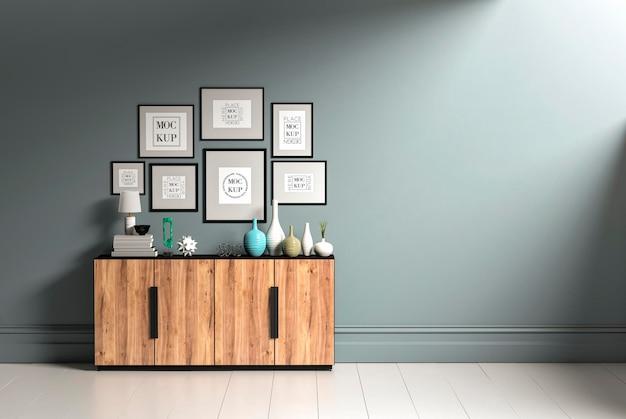 Alguns porta-retratos e um aparador de madeira na maquete da sala
