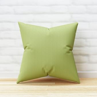 Almofada verde e forma quadrada no assoalho de madeira e fundo branco da parede de tijolo com modelo em branco. maquete de travesseiro para o projeto. renderização em 3d.