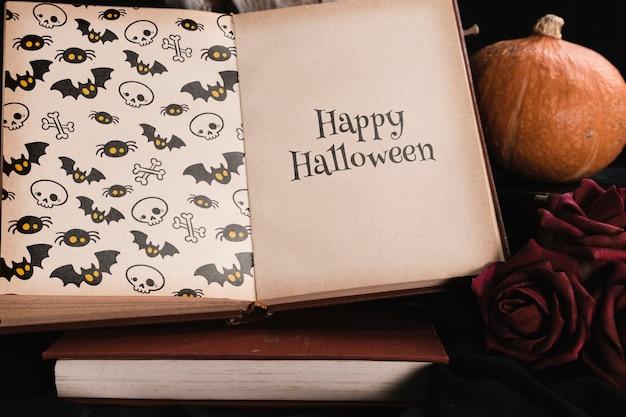 Alto ângulo do conceito de halloween com livro de mock-up