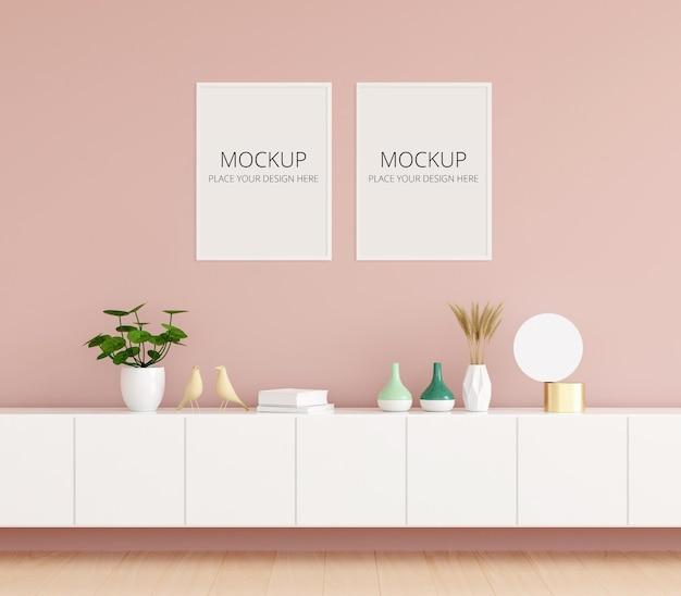 Aparador na sala rosa com maquete de moldura