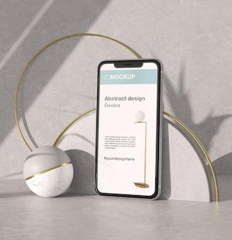 Apresentação de maquete de smartphone com pedra e elementos metálicos
