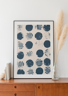 Art in a frame mockup por uma grama seca em um vaso