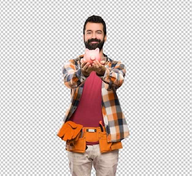 Artesãos homem segurando um piggybank